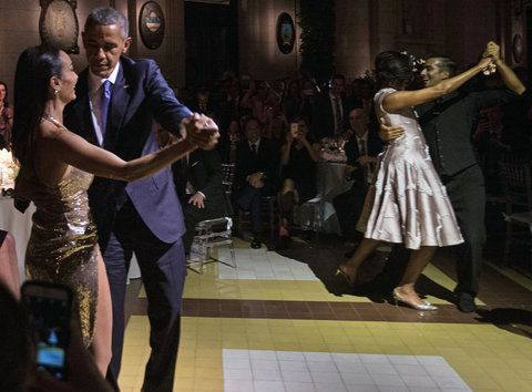 OS President Barack Obama (L) and First Lady Michelle Obama (2nd R) dance tango with dancers during a state dinner at the Kirchner Cultural Centre in Buenos Aires on March 23, 2016. The United States and Argentina sealed a major trade deal on the eve -the