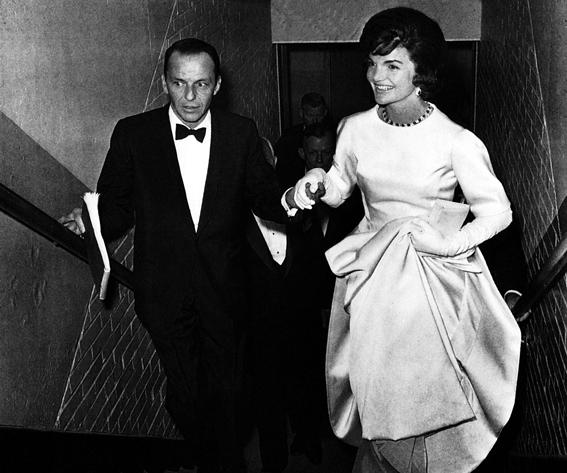 Jackie Onassis, Frank Sinatra escorting Jacqueline Kennedy to her box at a gala