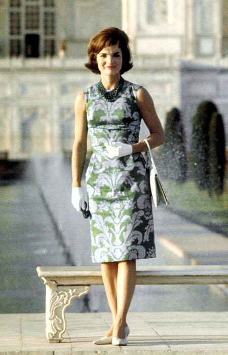 Jackie Onassis, First Lady Jackie Kennedy standing on the grounds of the Taj Mahal during visit to India