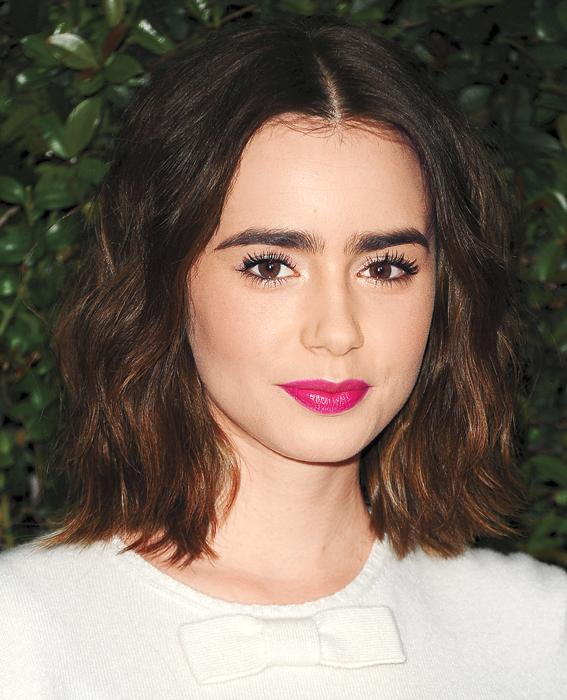 Lily Collins attends the Chanel and Charles Finch pre-Oscar dinner