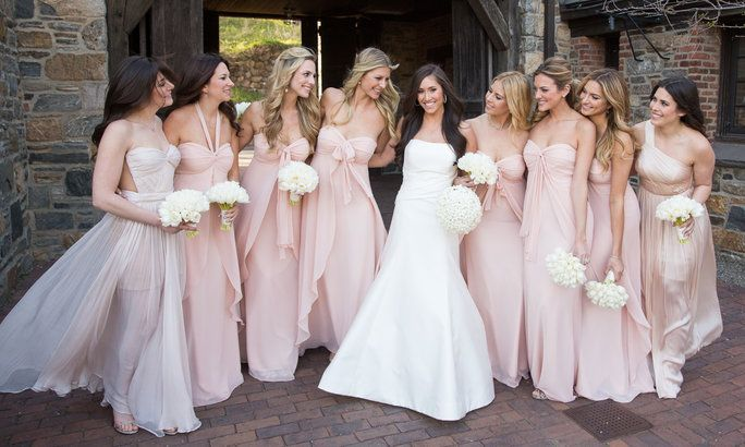 Alexandra (in Carolina Herrera from Mark Ingram Bridal) chose to dress her maids of honor (her sisters) in Rose Quartz gowns by Maria Lucia Hohan and her bridesmaids in Jenny Yoo
